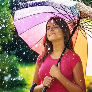 Peaceful Woman under umbrella