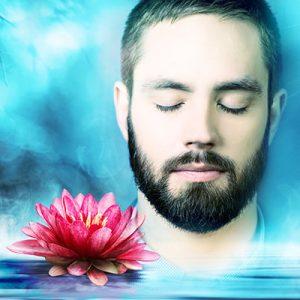 Meditating man with Lotus flower